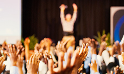 Blurred image of raised hands